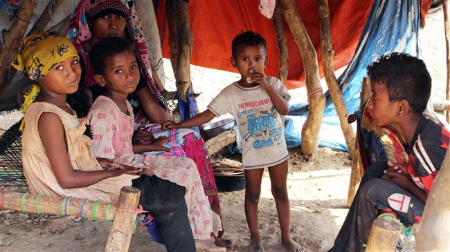 Displaced Yemeni children sit inside a tent at a make-shift camp for displaced people in the Haradh area, in the northern Abys district of Yemen. (Photo by AFP)